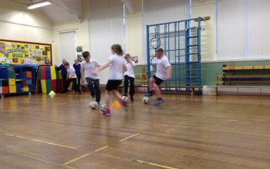 Football training in Year 6.