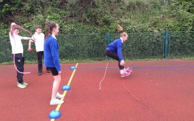 Year 6 outdoor athletics coaching session.