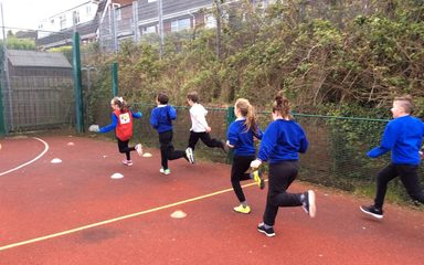 Outdoor athletic coaching: running.