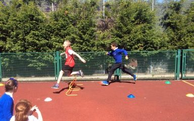 Outdoor athletic coaching: hurdles.